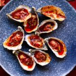 Barbecued oysters with garlic, paprika & Parmesan butter