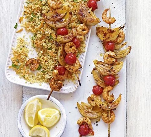 Harissa prawn skewers with carroty couscous Recipe