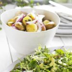 Zingy new potato salad