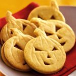 Orange pumpkin face cookies