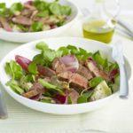 Lamb steaks with artichoke salad