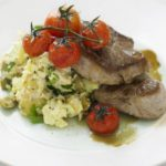 Lamb steaks with hummus new potatoes