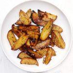Sticky potato wedges with sesame & lemon